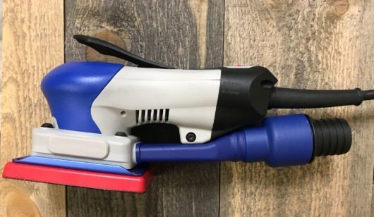 connects hose to sander